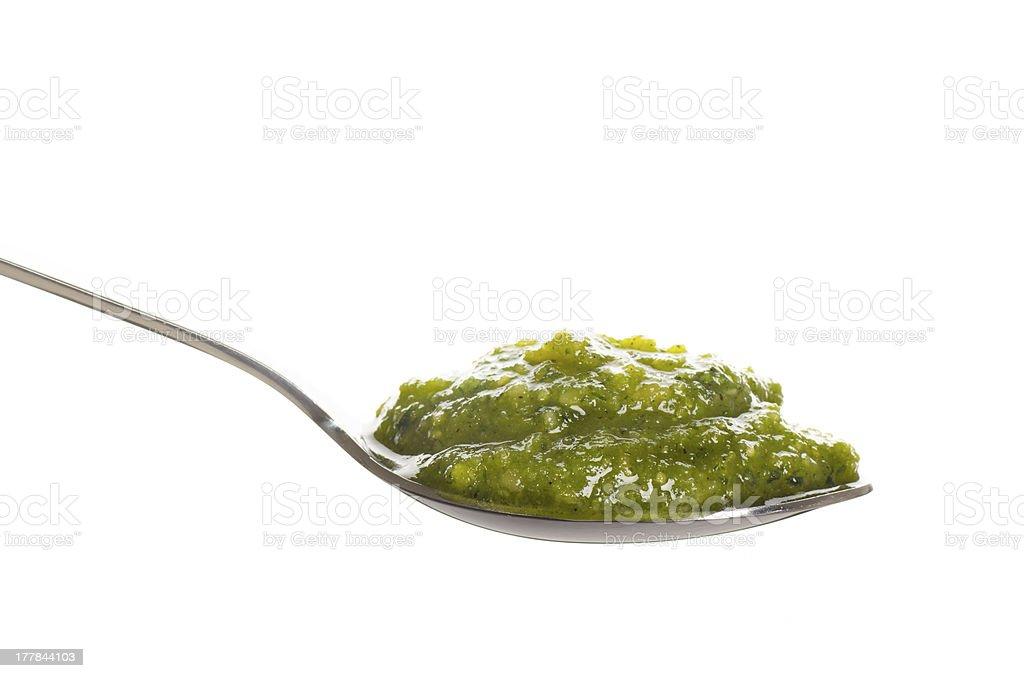 Green pesto in a spoon royalty-free stock photo