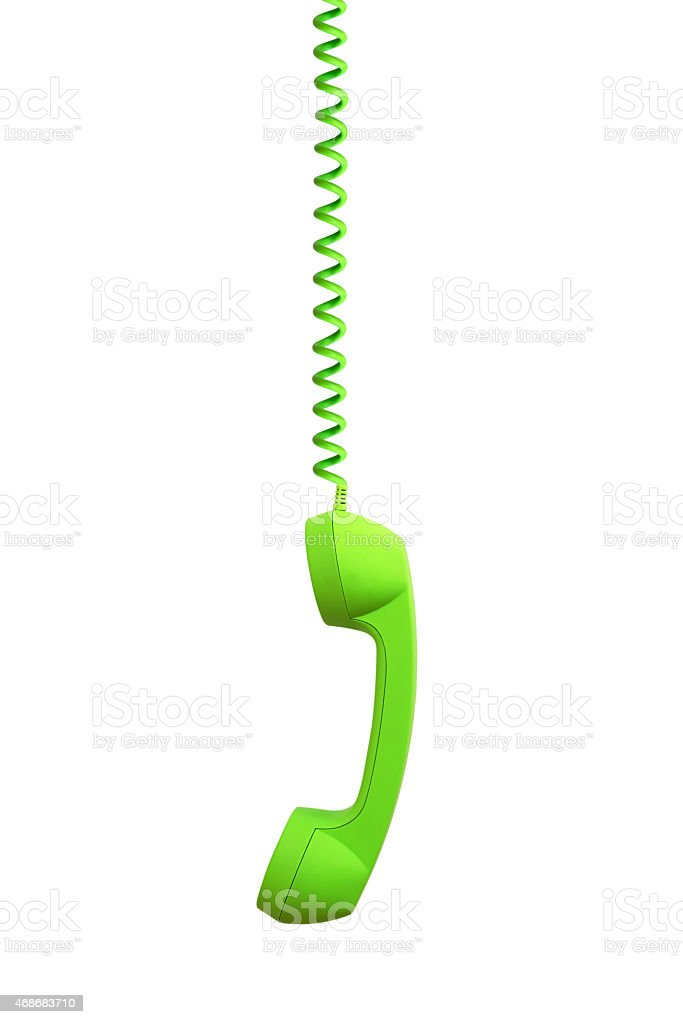 Green phone receiver hanging, isolated on white background stock photo