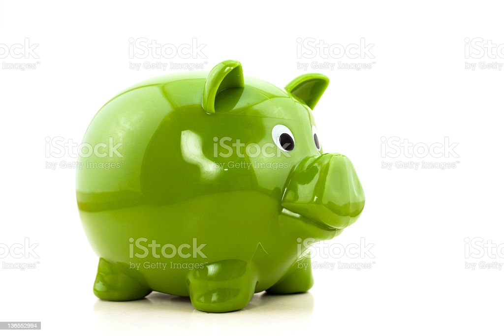 Green piggy bank on white royalty-free stock photo