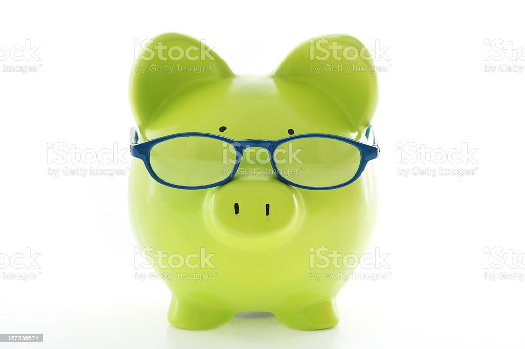 A green piggy bank wearing glasses royalty-free stock photo