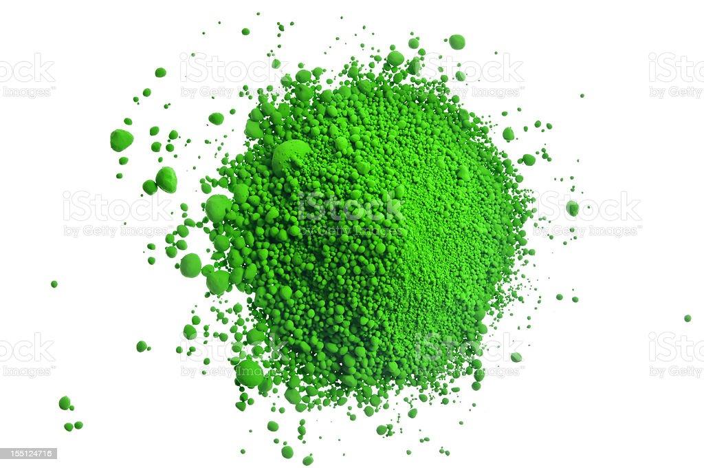 Green pile of pigment powder on white stock photo