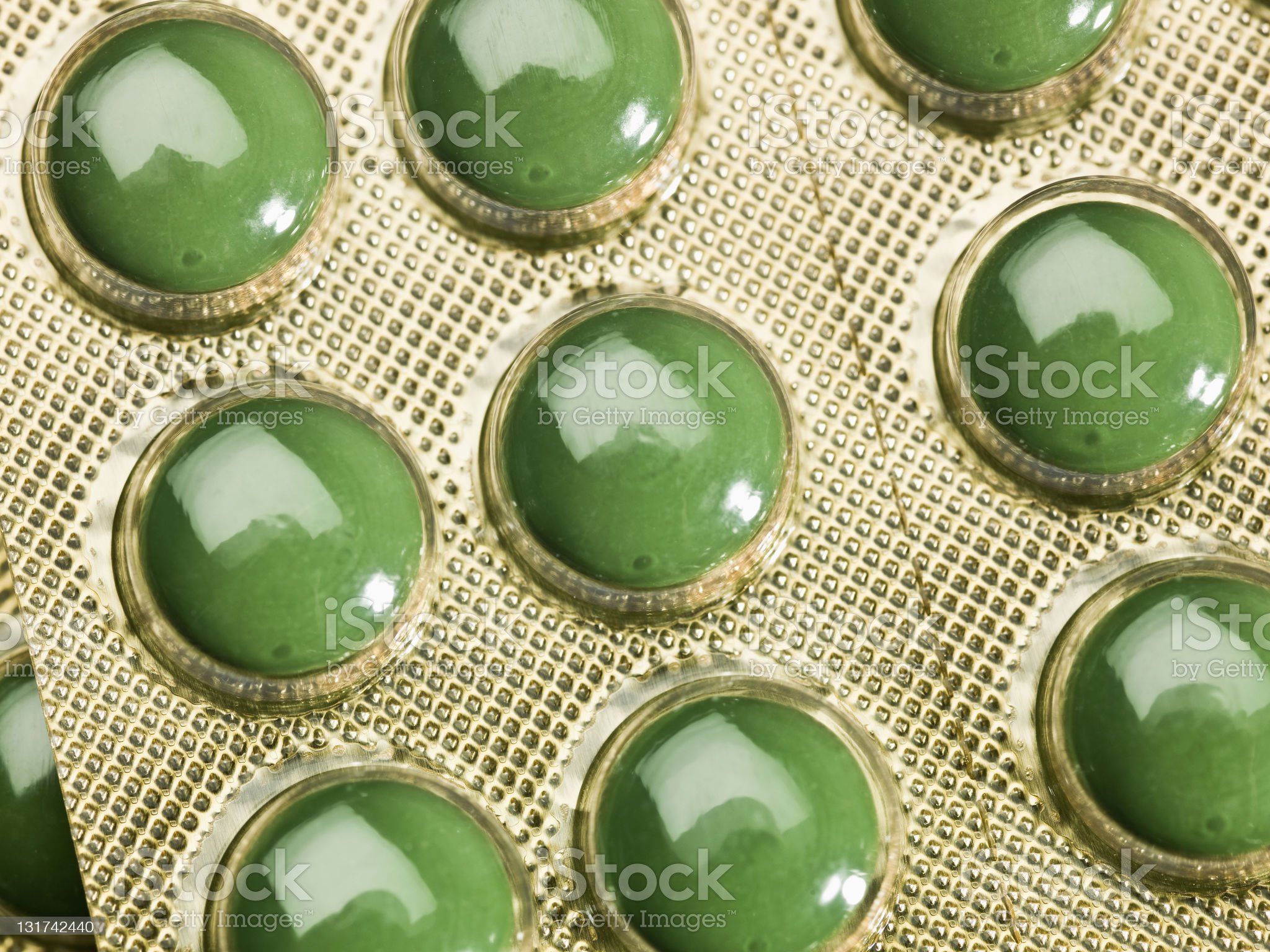 Green pills in a blister pack royalty-free stock photo