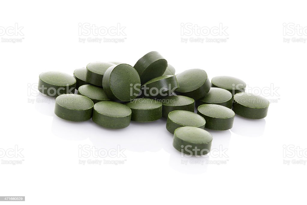 Green pills isolated on white background. stock photo
