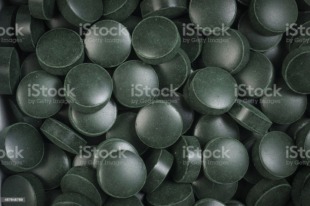 Green pills, spirulina royalty-free stock photo