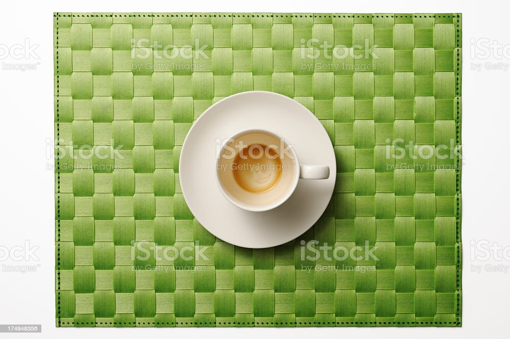 Green place mat with finished drinking coffee on white background royalty-free stock photo