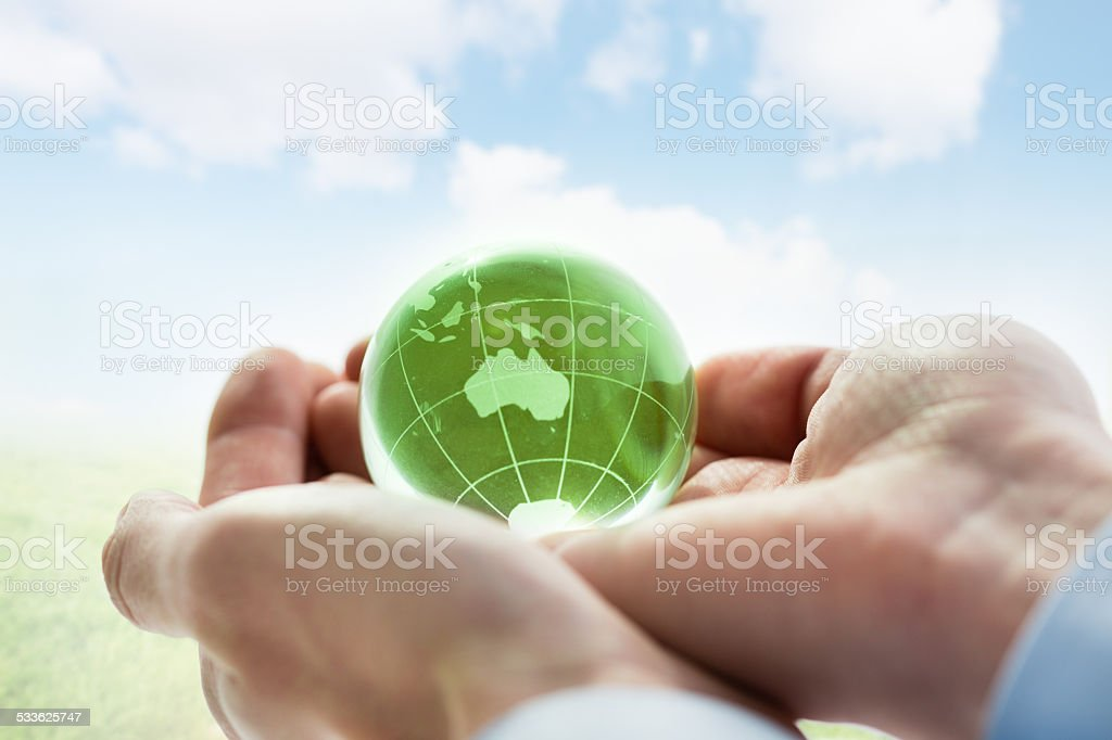 Green planet Earth in hands stock photo