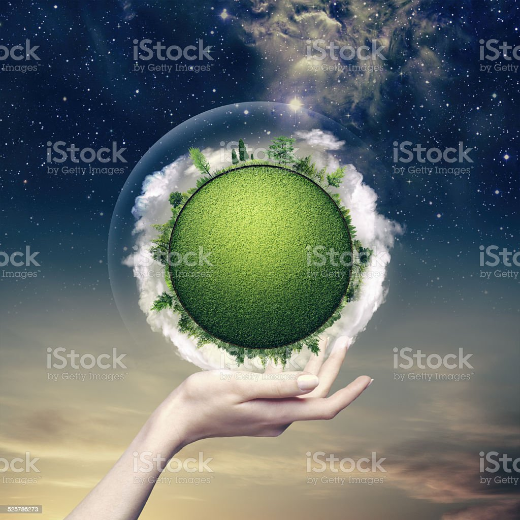 Green planet into the human hand, environmental backgrounds stock photo