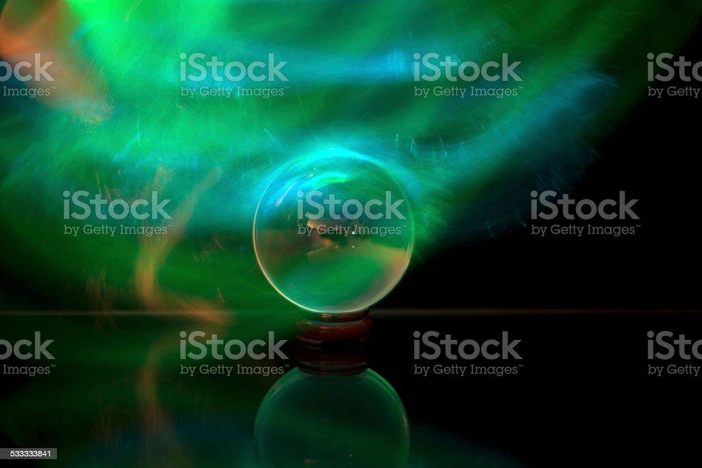 green plasma around glass orb stock photo