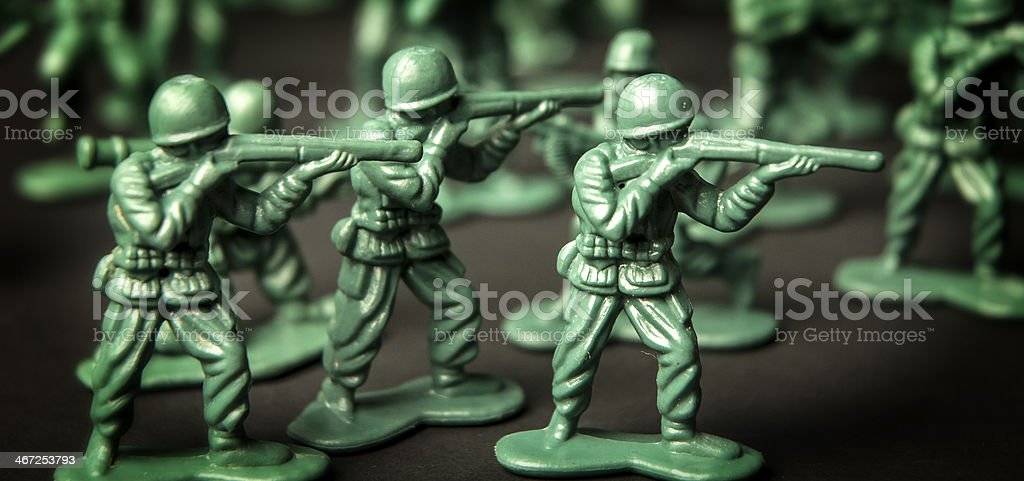 Green Plastic Army Men With Weapons Macro stock photo