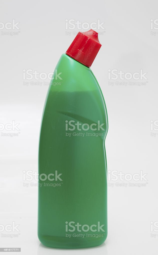 green plastic bottle of toilet cleanser on plain background stock photo