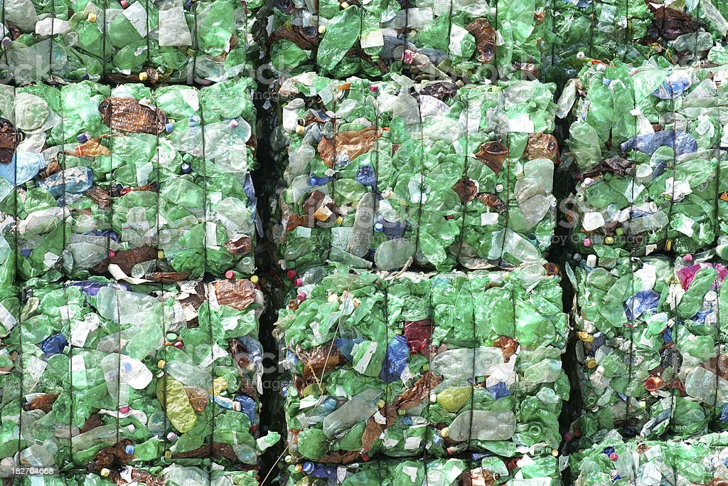 Green plastic bottles ready for recycling royalty-free stock photo