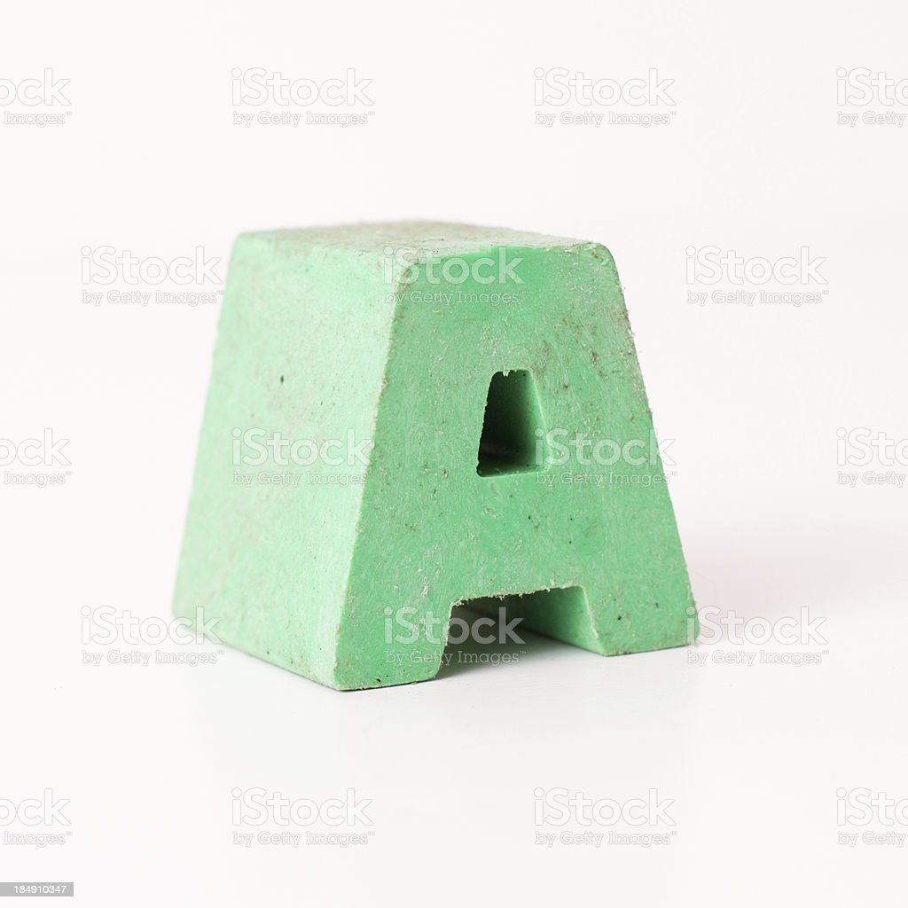 Green Plastic Capital Letter A on White Background stock photo
