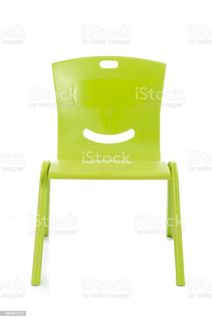 Green plastic chair isolated stock photo
