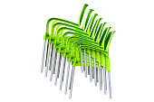 green plastic chairs stacked in piles isolated on white background