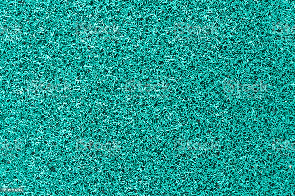 Green plastic fur texture stock photo