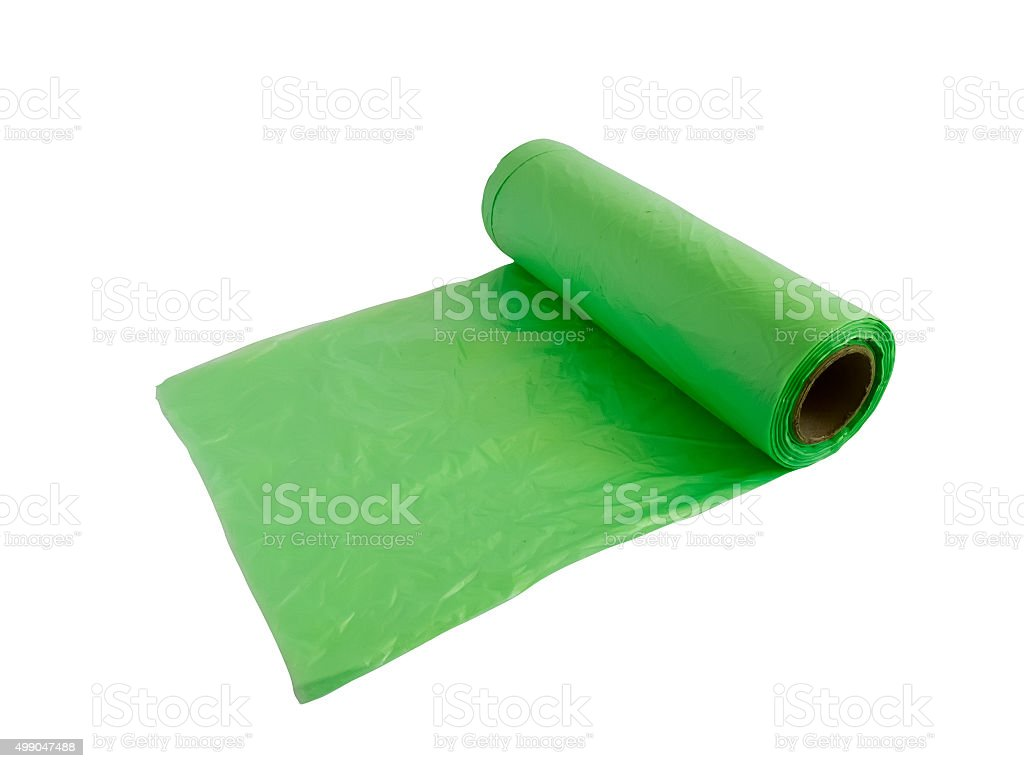 Green plastic garbage bags stock photo