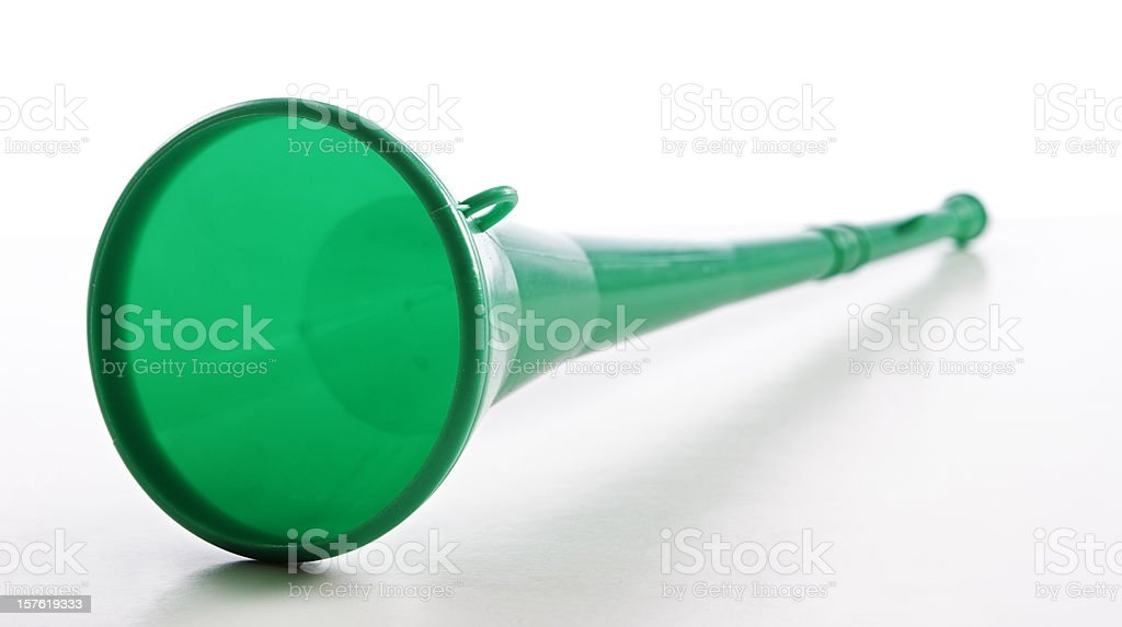 Green plastic vuvuzela to blow at soccer matches royalty-free stock photo