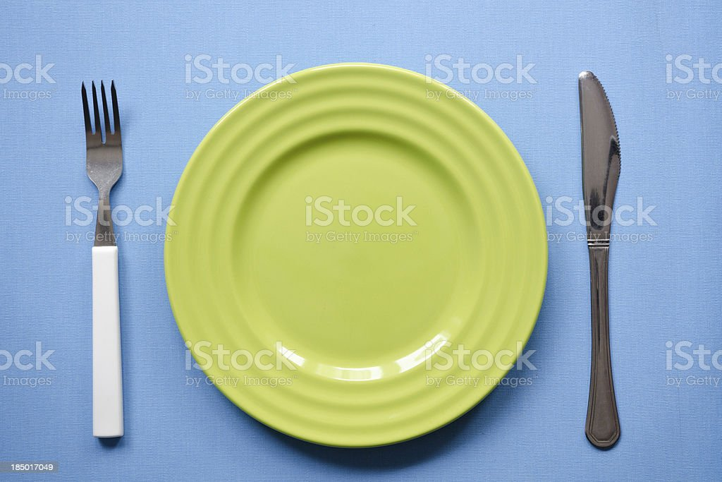green plate on blue royalty-free stock photo