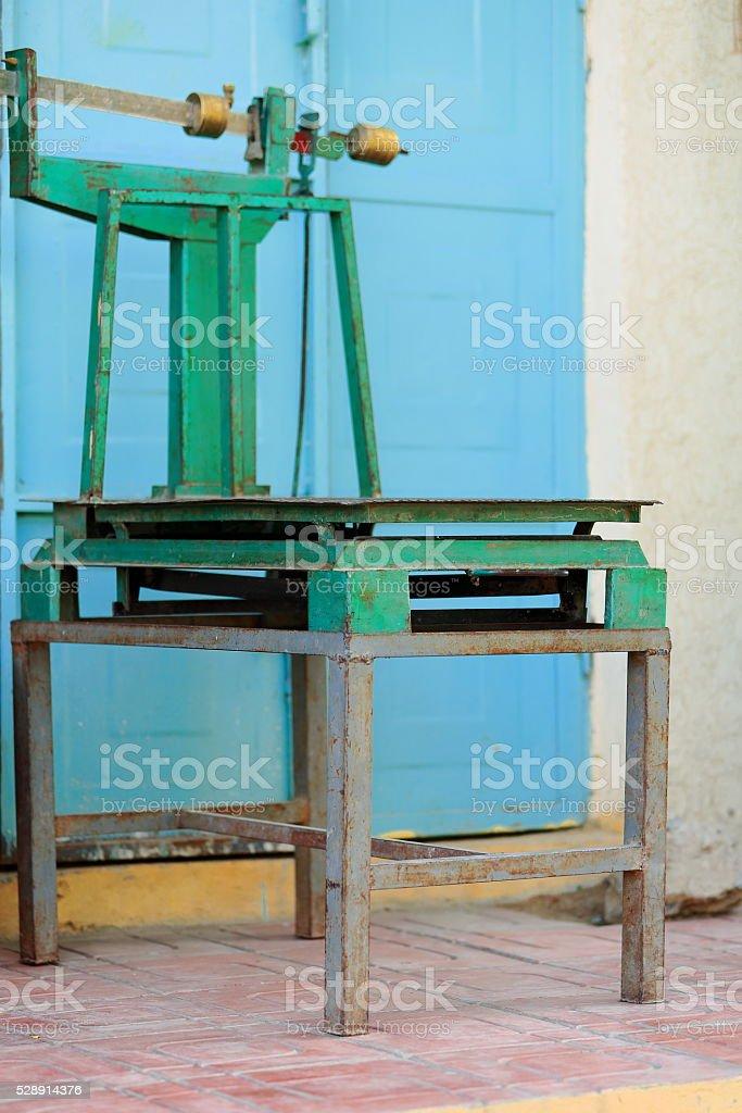 Green platform scale before blue door. Mekelle-Ethiopia. 0484 stock photo