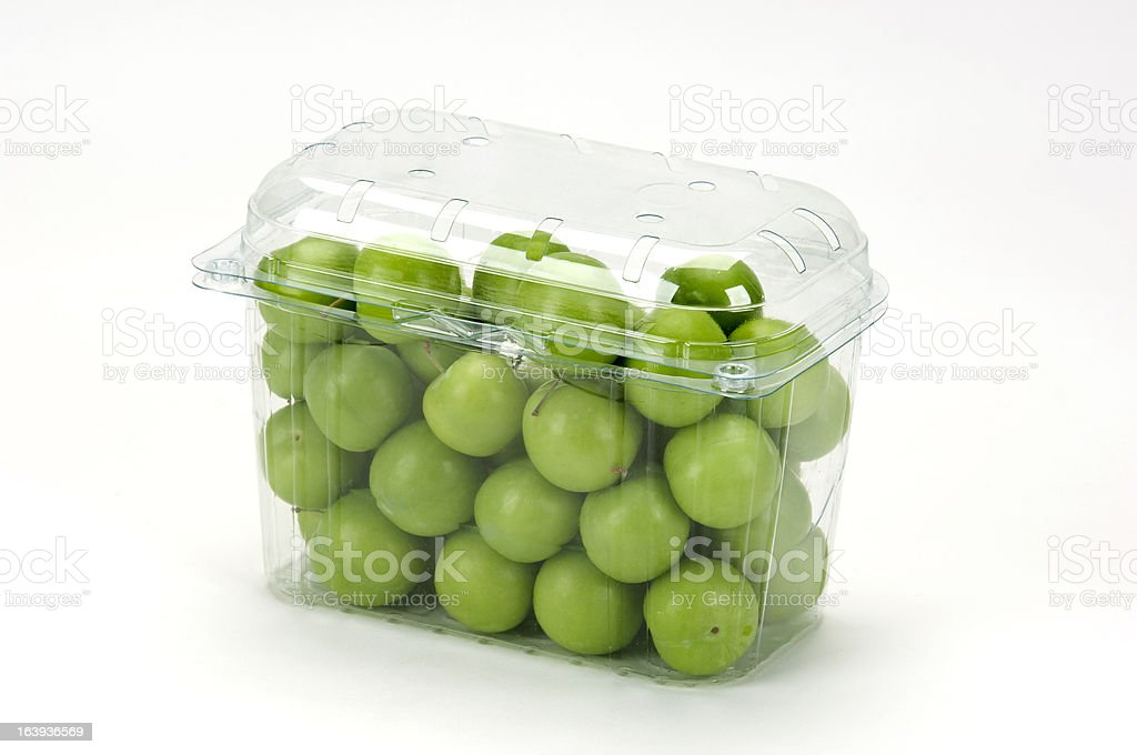 green plums(greengages) in a plastic box royalty-free stock photo