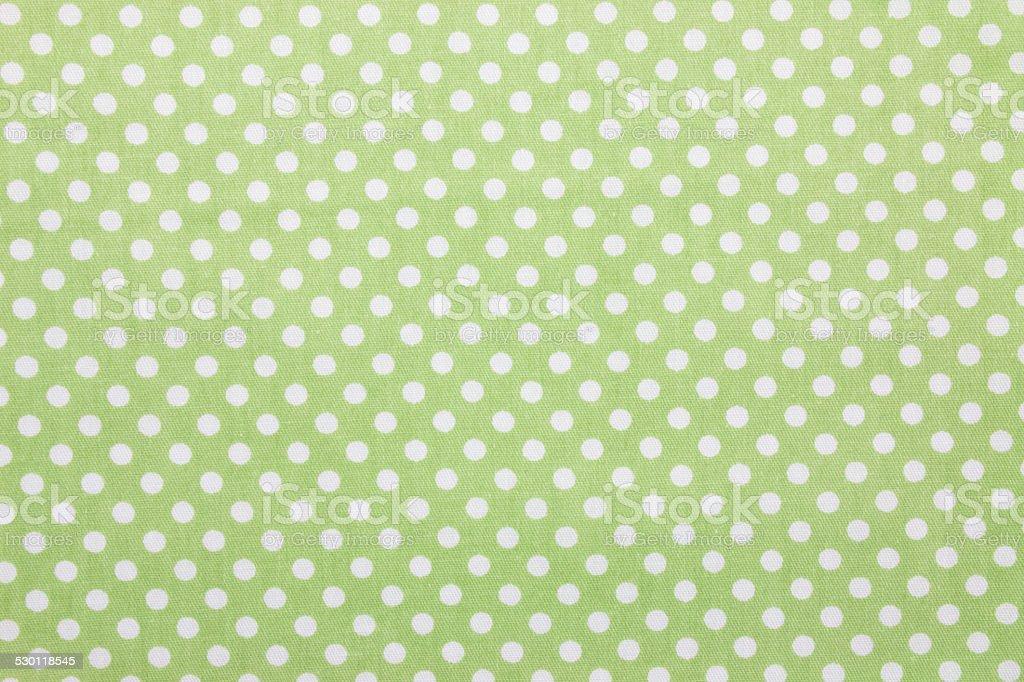 green polka dot fabric stock photo