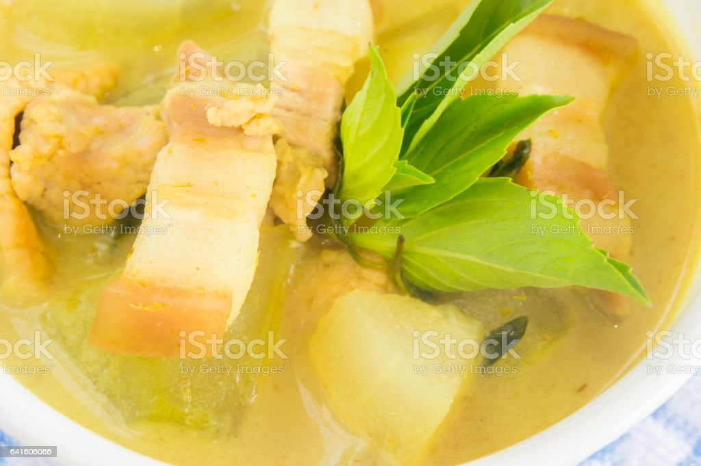 Green pork curry with old wooden background , Thai cuisine stock photo