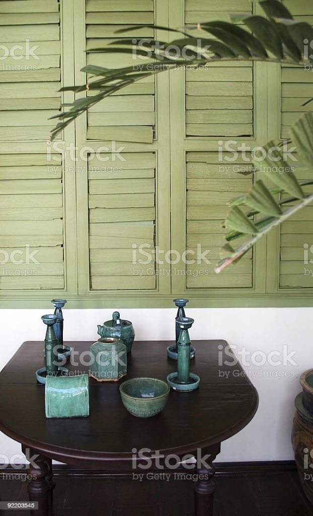 Green pottery on a table royalty-free stock photo