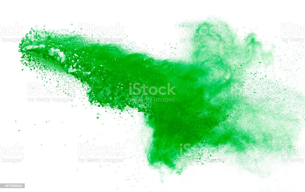 Green powder explosion isolated on a white background stock photo