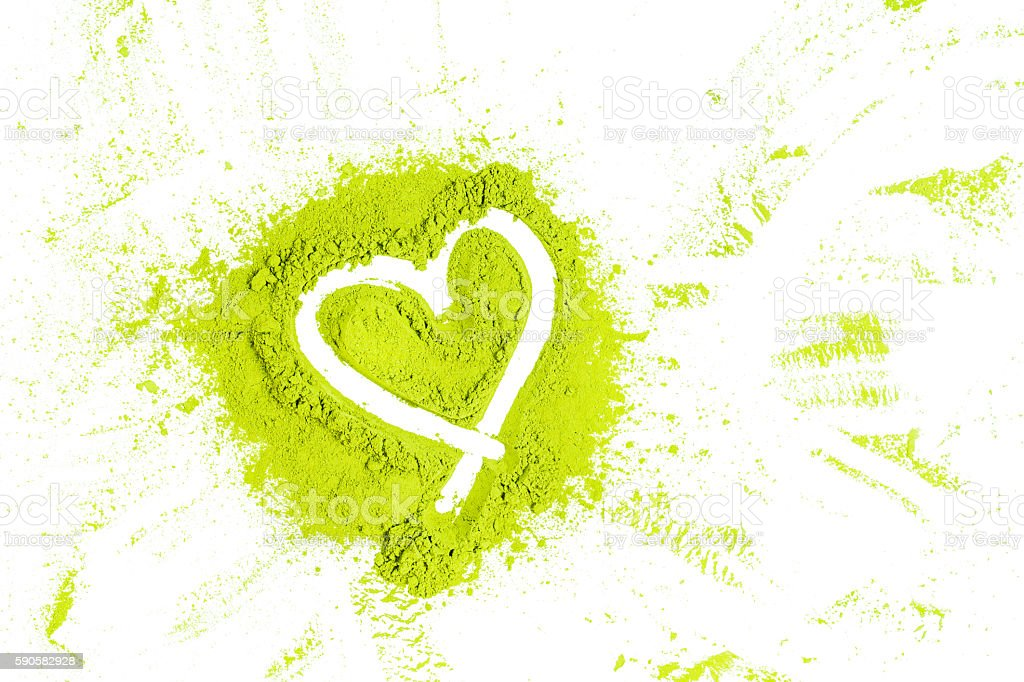 green powder forming heart shape surface close up stock photo