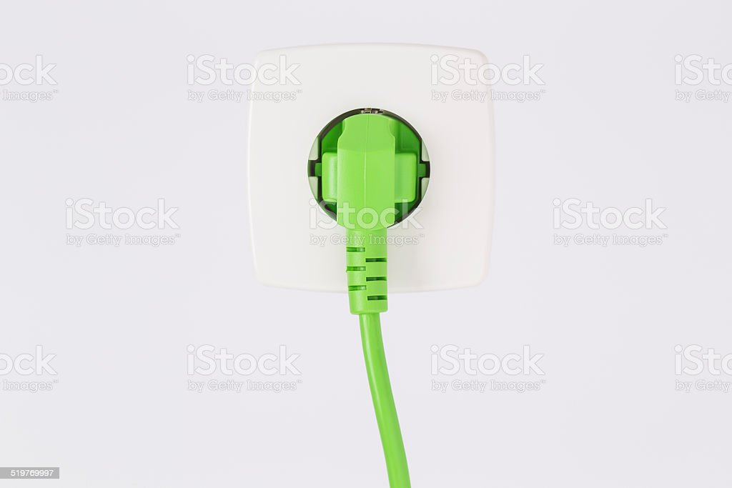Green power plug and outlet stock photo