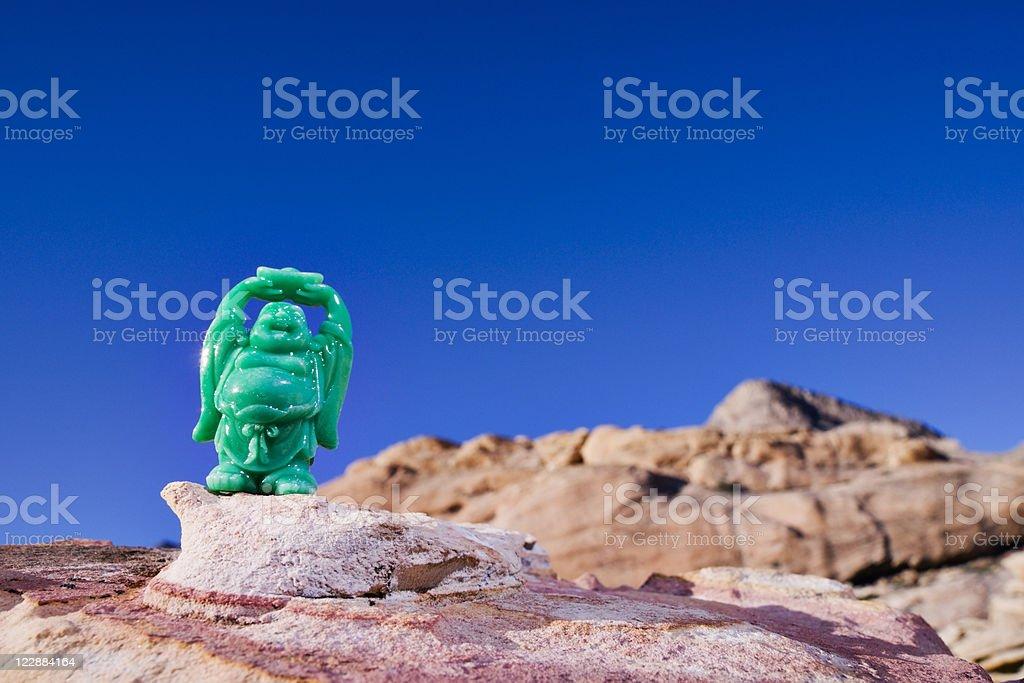 Green Prosperity Buddha Maitreya and Sandstone Hills royalty-free stock photo