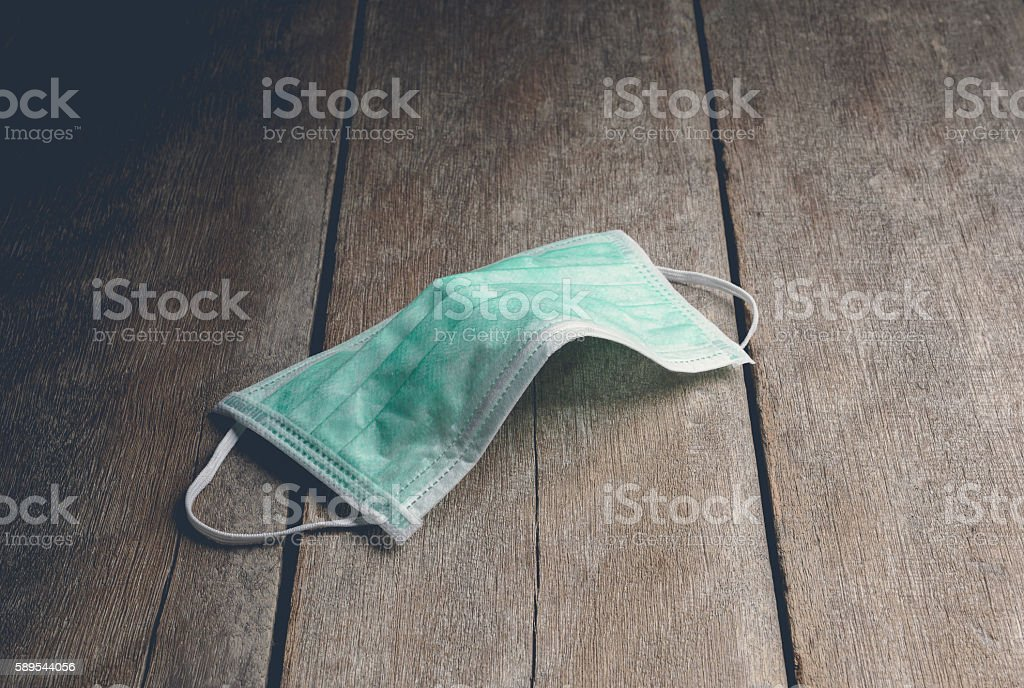 green protective mask stock photo