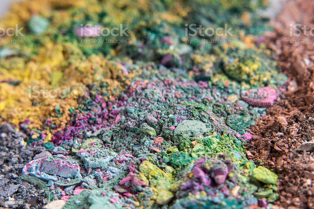 green, purple and pink eyeshadows powder pile stock photo