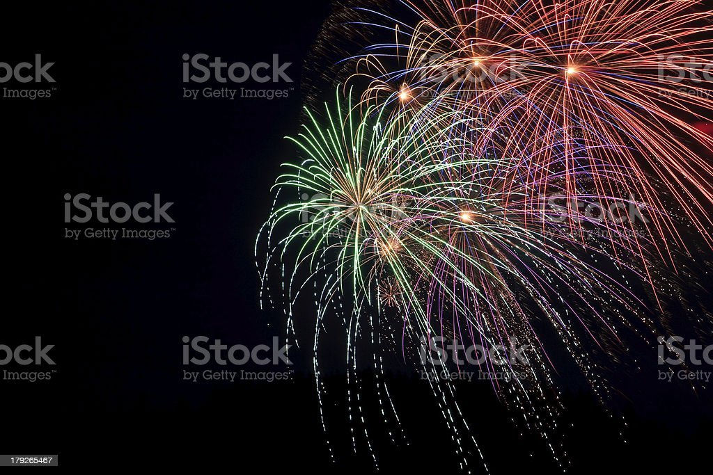 Green purple orange and red fireworks royalty-free stock photo