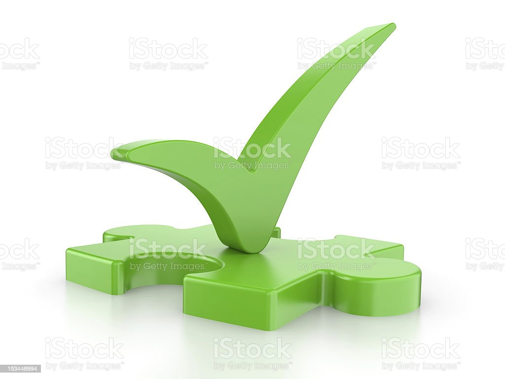 Green puzzle with a check royalty-free stock photo