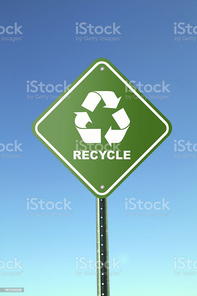 Green recycling road sign against blue sky royalty-free stock photo