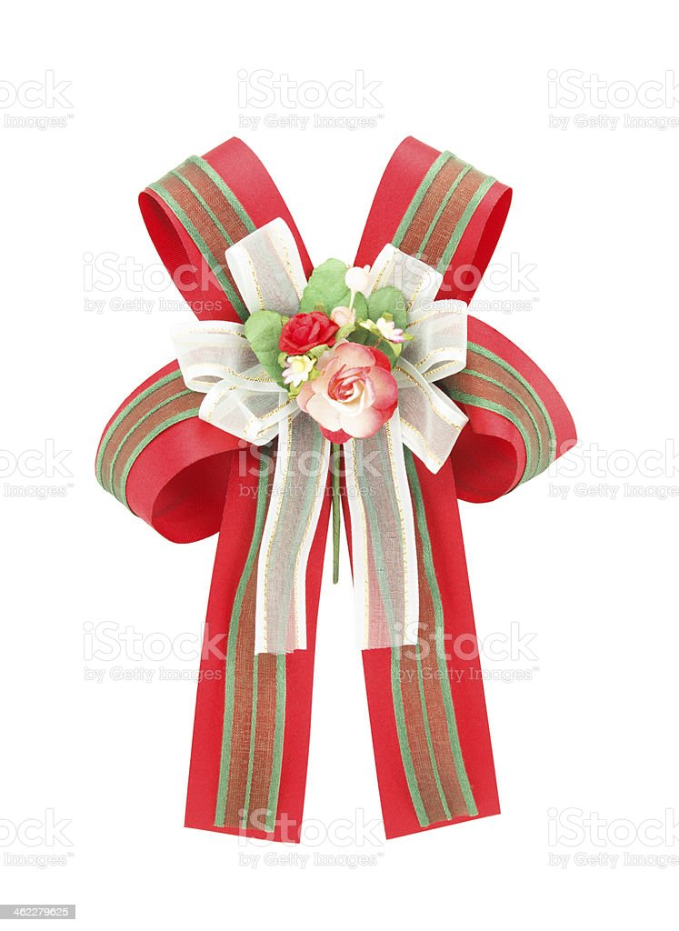 green  red bow with artificial rose flowers on white background stock photo