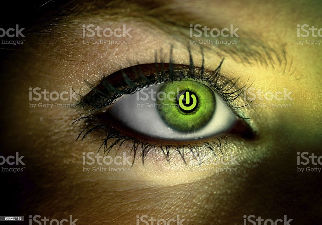 Green reflection of on and off computer button in an eye stock photo