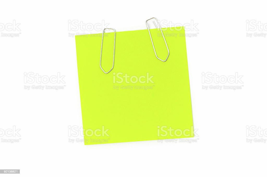 Green reminder note with paperclips isolated on the white royalty-free stock photo