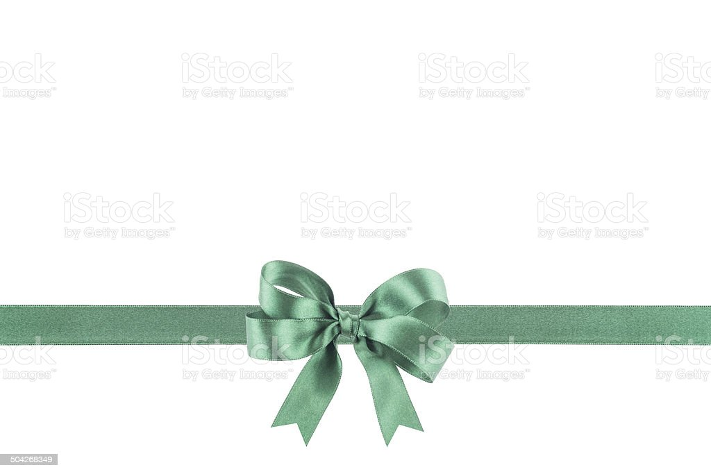 Green ribbon with a bow on white background stock photo