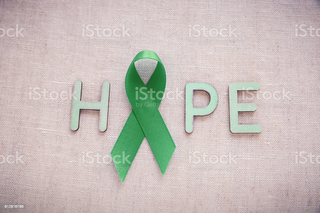 Green Ribbon with HOPE word, cancer awareness, Liver, kidney can stock photo
