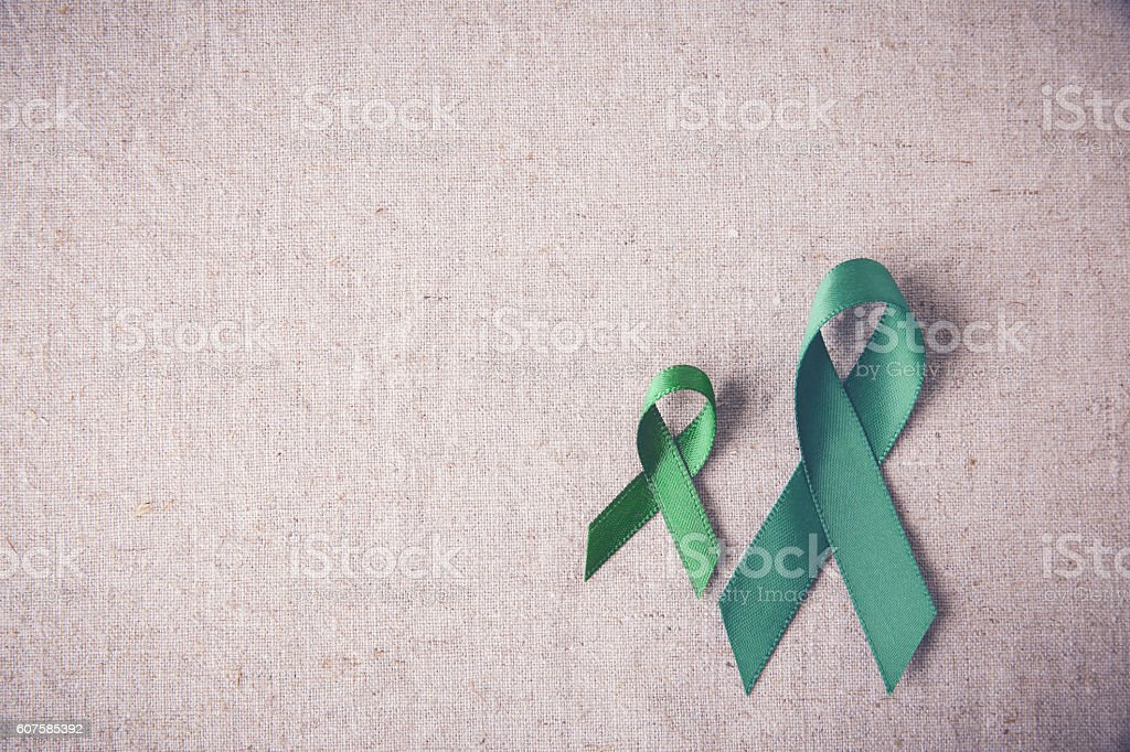 Green Ribbons copy space toning background, cancer awareness, Li stock photo