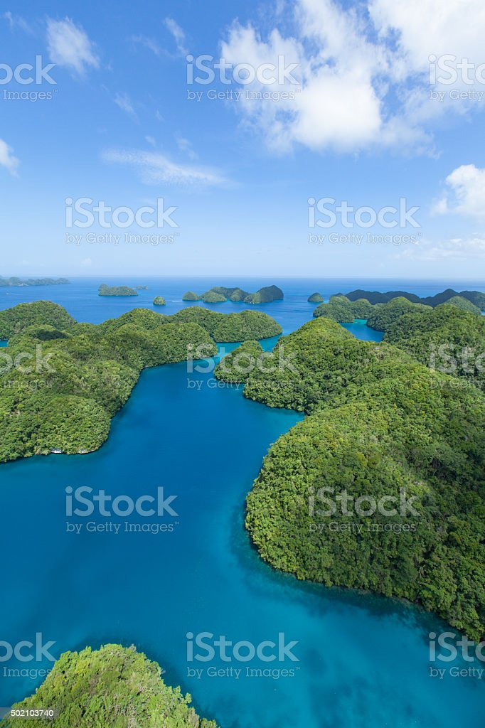 Green rock islands and blue tropical water from above, Palau stock photo