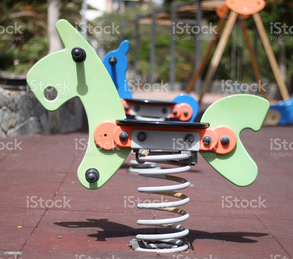 Green rocking horse stock photo