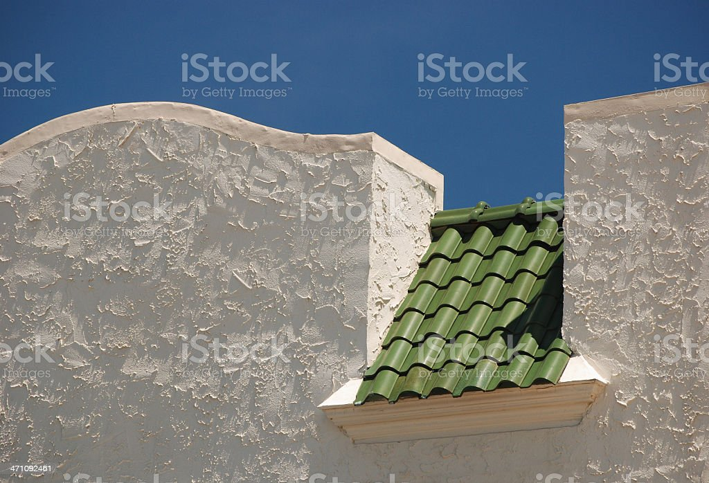 Green Roof & stucco wall royalty-free stock photo