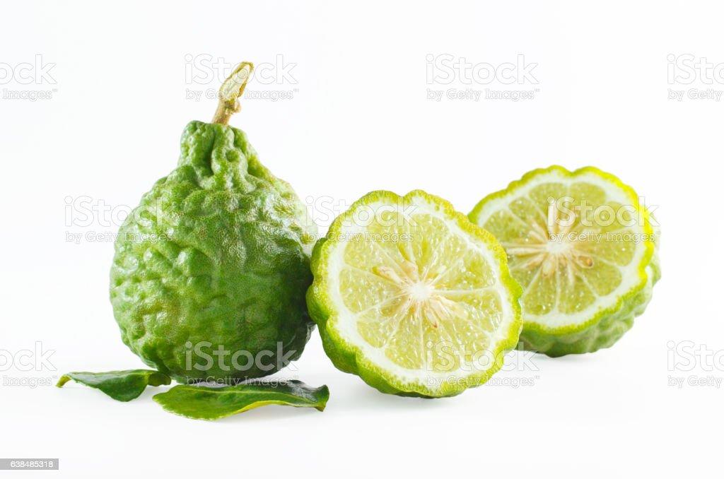 Green rough peel bergamot fruit or kaffir lime isolated stock photo