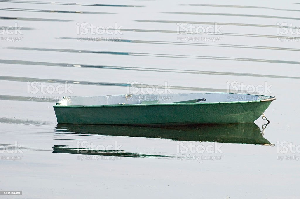 green row boat with ripples royalty-free stock photo