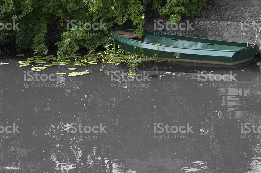 green rowboat with copy space royalty-free stock photo