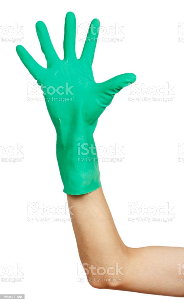 Green rubber glove on male hand stock photo