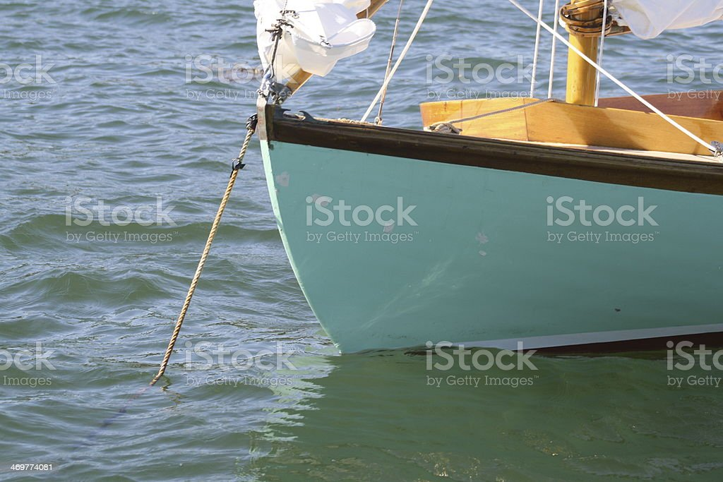 Green Sailboat Anchored in the Harbor royalty-free stock photo